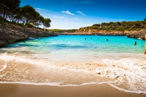 Beautiful view of Mediterranean beach with clear blue sky and se